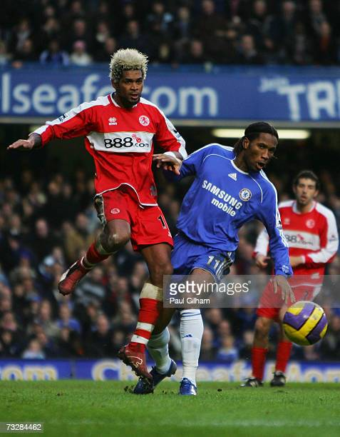 Abel Xavier of Middlesbrough challenges Didier Drogba of Chelsea during the Barclays Premiership match between Chelsea and Middlesbrough at Stamford...