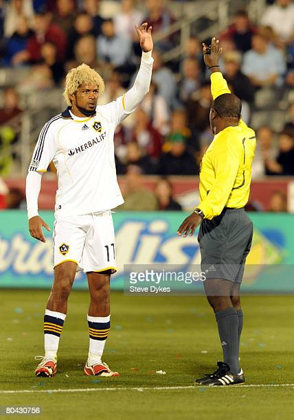 Abel Xavier of the Los Angeles Galaxy shares his opinion with the Referee Abiodun Okaluja in the first half of the MLS soccer game at Dick's Sporting...