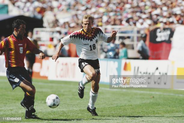 Abelardo Fernandez of Spain and Jurgen Klinsmann of Germany compete for the ball during play between Germany and Spain in their 1994 FIFA World Cup...