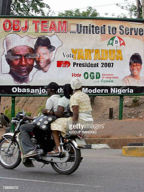 A taximoto drives past a People's Democratic Party party poster 20 April 2007 in Abeocuta ahead of elections 22 April There are 25 candidates for the...