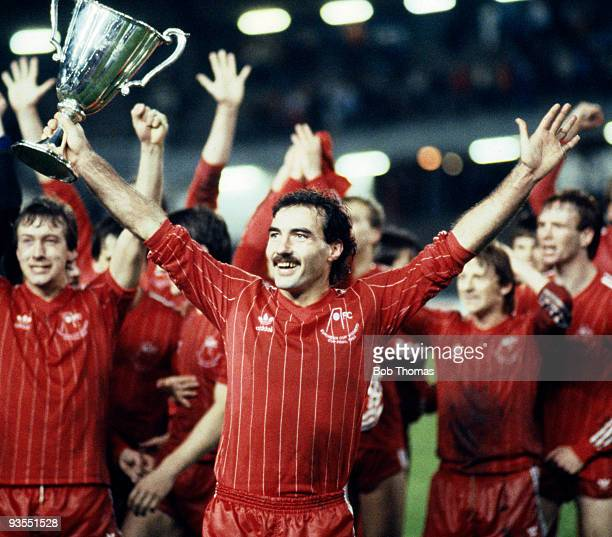 Aberdeen captain Willie Miller and his teammates celebrate with the trophy after their 21 victory over Real Madrid in the European Cup Winners Cup...