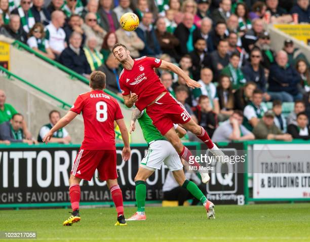 Aberdeen centreback Dominic Ball wins the header during the second half as Hibernian play host to Aberdeen at Easter Road on August 25 2018 in...