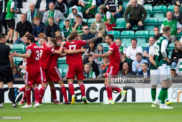 Aberdeen centreback Tommie Hoban is mobbed by teammates after scoring his sides opening goal during the first half as Hibernian play host to Aberdeen...