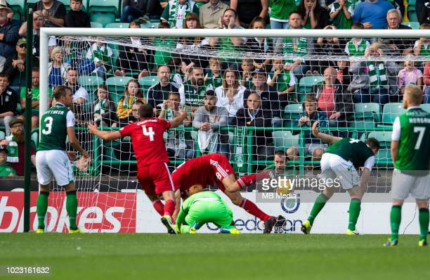 Aberdeen centreback Tommie Hoban scrambles the ball over the line to score his sides opening goal during the first half as Hibernian play host to...