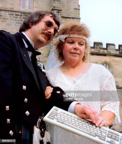 Aberdeen computer buff Adrian Philpott and his wife Cindy pose for photos after their wedding at King's College Chapel in Aberdeen on August 19 1996...