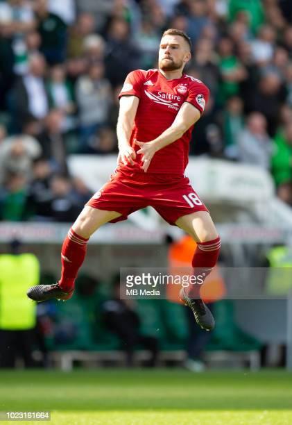Aberdeen defender Michael Devlin warms up before kick off as Hibernian play host to Aberdeen at Easter Road on August 25 2018 in Edinburgh Scotland