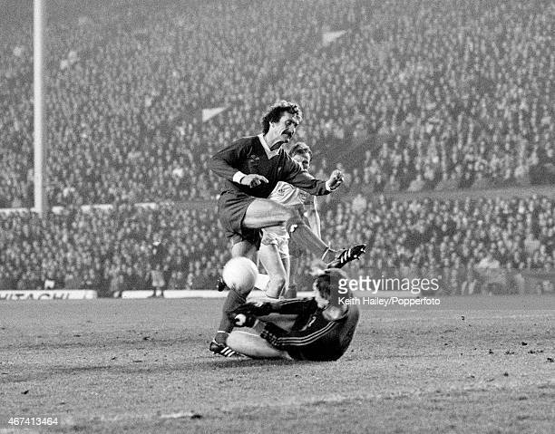 Aberdeen goalkeeper Jim Leighton bravely saves at the feet of Liverpool's Terry McDermott during the European Cup 2nd round 2nd leg match between...