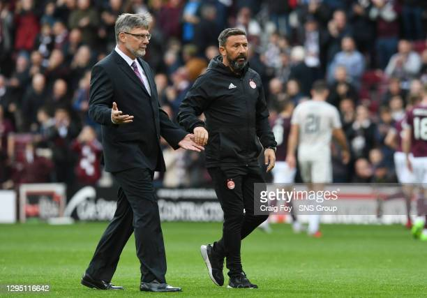 Aberdeen manager Derek McInnes and Hearts manager Craig Levein exchnage words with referee Kevin Clancy