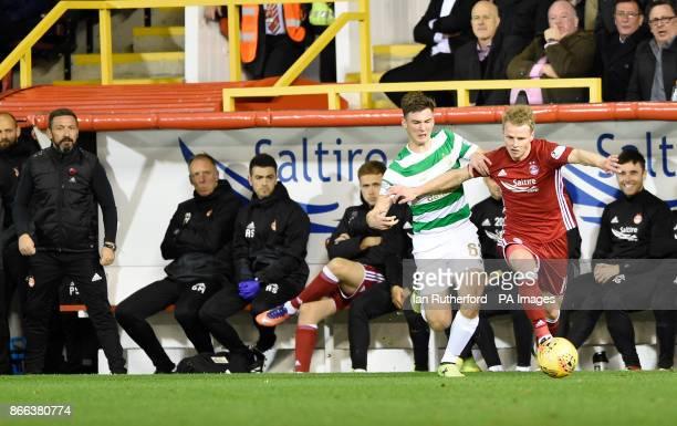 Aberdeen manager Derek McInnes looks on from the technical area as Celtics Kieran Tierney and Aberdeen's Gary Mackay-Steven battle for the ball...