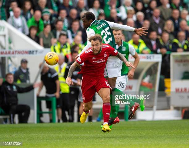 Aberdeen striker Stevie May evades Hibs' Nigerian defender Efe Ambrose during the second half as Hibernian play host to Aberdeen at Easter Road on...