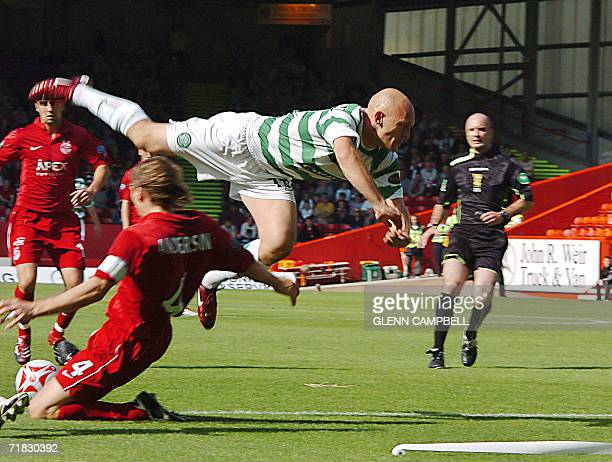 Aberdeen, UNITED KINGDOM: Glasgow Celtic new player Denmark midfielder Thomas Gravesen is tackled as he makes his debut for his new team in the...
