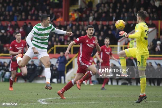 Aberdeen's Freddie Woodman saves from Celtic's Tom Rogic during the Scottish Premiership match at Pittodrie Stadium Abderdeen