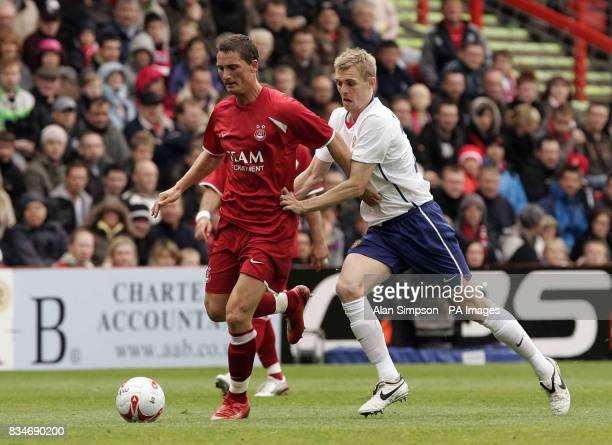 Aberdeen's Gary McDonald and Manchester United's Darren Fletcher during the PreSeason Friendly at Pittodrie Stadium Aberdeen
