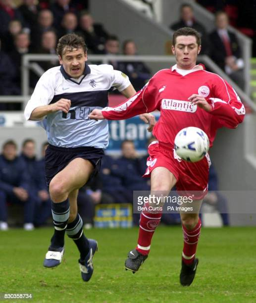 Aberdeen's Jamie McAllister and Rangers Andrei Kanchelskis fight for the ball during their Bank of Scotland Premiership football match at Aberdeen's...