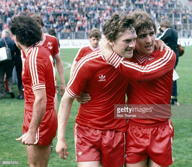 Aberdeen's Mark McGhee hugs teammate Dougie Bell after their victory over Glasgow Rangers in the Scottish FA Cup Final held at Hampden Park Glasgow...