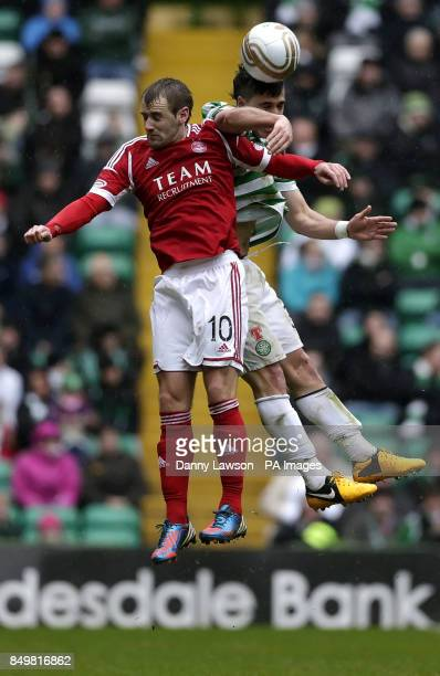 Aberdeen's Niall McGinn and Celtic's Beram Kayal fight for the ball during the Clydesdale Bank Scottish Premier League match at Celtic Park Glasgow