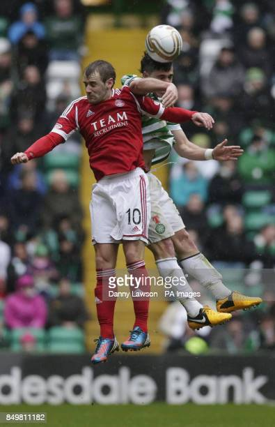Aberdeen's Niall McGinn and Celtic's Beram Kayal jump for the ball during the Clydesdale Bank Scottish Premier League match at Celtic Park Glasgow