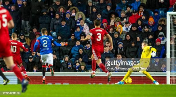 Aberdeen's Niall McGinn slots past Rangers goalkeeper Allan McGregor to make it 1-0 to the away side