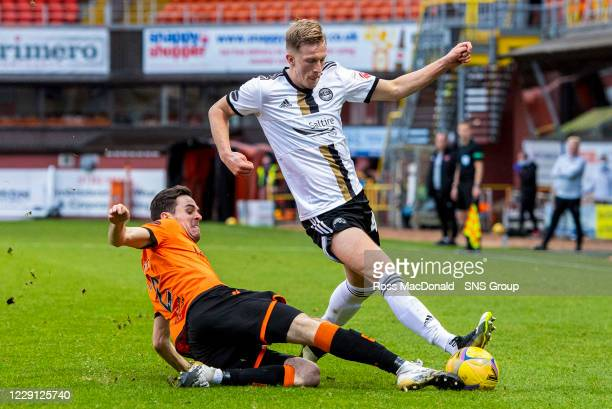 Aberdeen's Ross McCrorie is challenged by Dundee United's Liam Smith during a Scottish Premiership match between Dundee United and Aberdeen at...