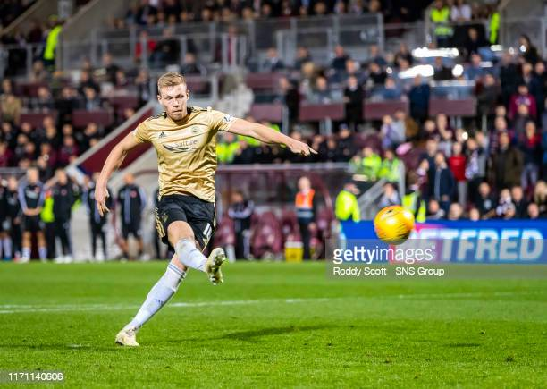 Aberdeens Sam Cosgrove misses a penalty during the penalty shootout in the Betfred Cup Quarter-Final match between Heart of Midlothian and Aberdeen...
