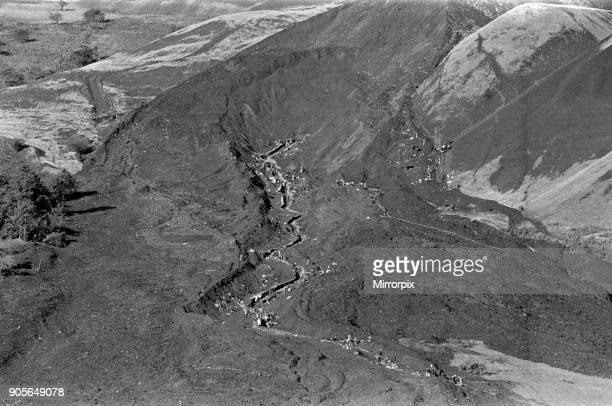Local emergency services and miners travel high up onto the hillside to put up sand bags along the route of the mud slide to stem any further flow of...