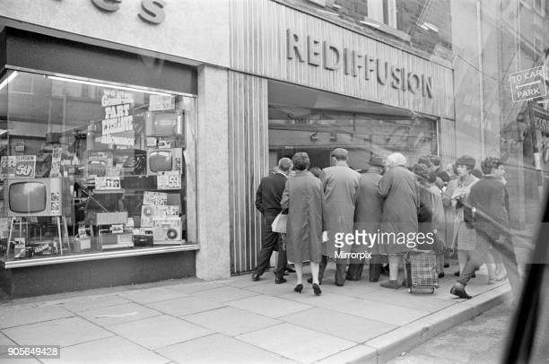 Local people in Aberfan gather in mass to watch the news reports of the Aberfan disaster in the town's Rediffusion Television Shop The Aberfan...