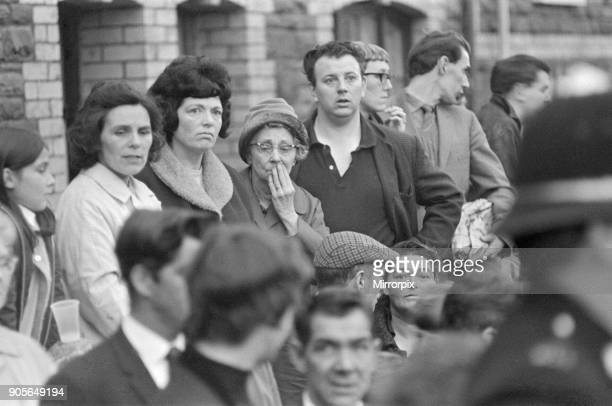 Onlookers in the town of Aberfan young and old look shocked and bewildered as the rescue effort at The Pantglas Junior School goes on The Aberfan...
