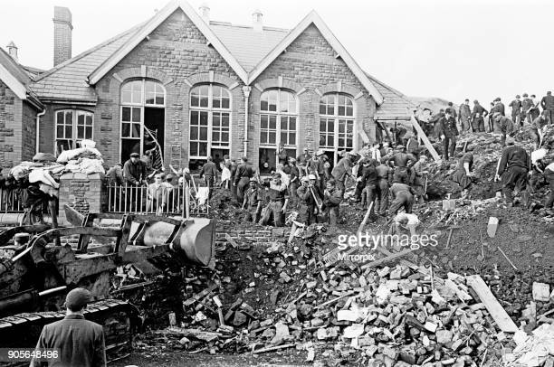 Aberfan, South Wales, 21st October 1966 Picture shows the mud and devastation caused when mining spoil from the hillside high above the town behind...