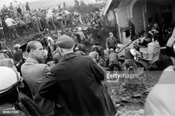 Aberfan South Wales 22nd October 1966 The Duke of Edinburgh visits Aberfan and is seen here at the site of The Pantglas Junior School talking with...