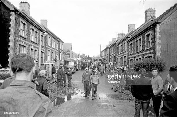 Picture shows the mud and devastation caused when mining spoil from the hillside high above the town behind came down and engulfed The Pantglas...
