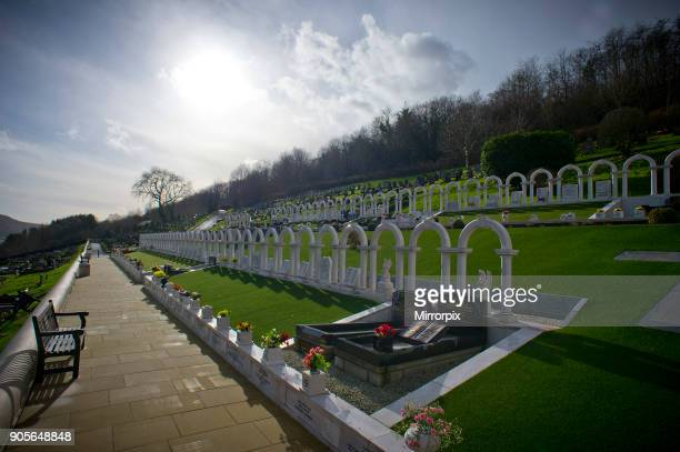 The cemetery behind that sits behind the houses of Aberfan South Wales Two rows of white arches near the top of Aberfan cemetery mark the graves of...