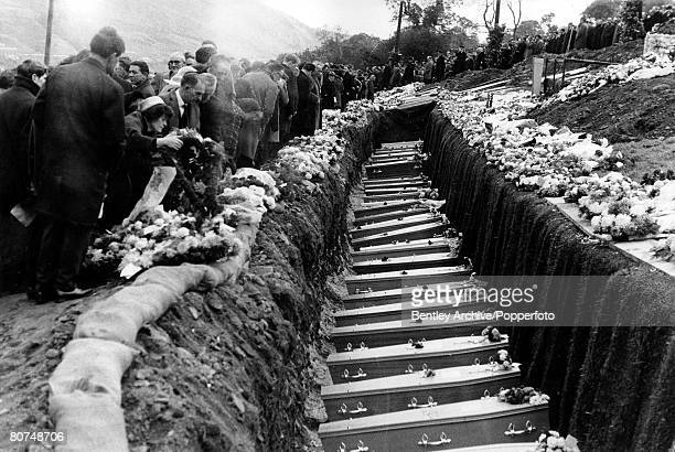Aberfan Wales 28th October A line of coffins of 82 victims of the Aberfan disaster lie in their grave on the hillside following the funeral service...