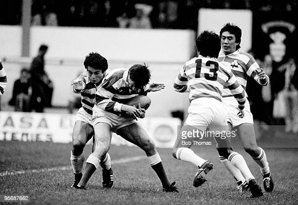 Abertillery's David George is caught in a trap by Japan's Jiro Ishiyama Kazuhiko Honjo and Hikari Kawachi during the Abertillery RFC versus Japan...