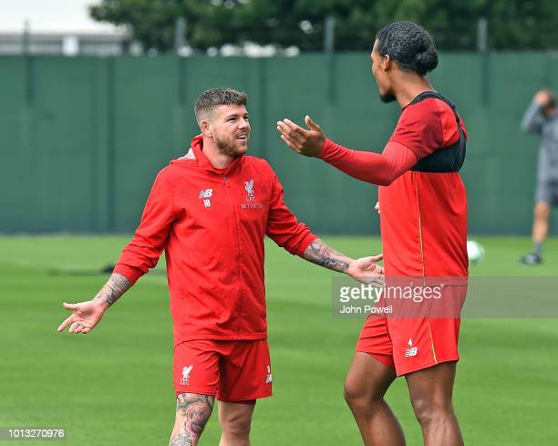 Aberto Moreno with Virgil van Dijk of Liverpool during a training session at Melwood Training Ground on August 8 2018 in Liverpool England