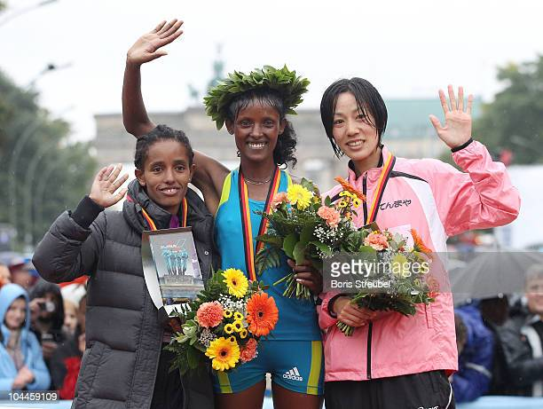 Aberu Kebede of Ethiopia receives the gold medal Bezunesh Bekele of Ethiopia receives the silver medal and Tomo Morimoto of Japan receives the bronze...