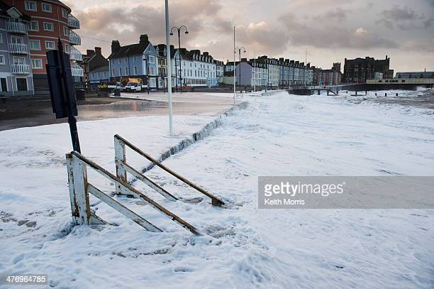 CONTENT] Aberystwyth Wales UK Sunday 02 Feb 2014 Gale force winds and a 57m high spring tide again brought huge waves on to the promenade at...