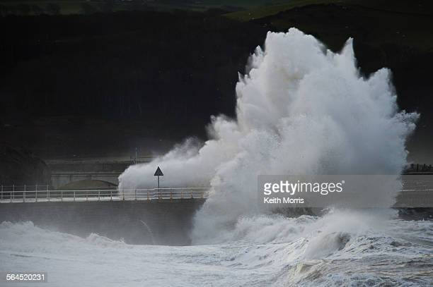 Aberystwyth Wales UK Wednesday 18 December 2013 At the peak of the tide gale force winds bring massive waves crashing onto the seafront at...