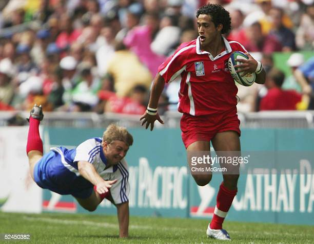 Abess Kherfani of Tunisia makes a break against Russia on day two of the Rugby World Cup Sevens held at Hong Kong Stadium March 19 2005 in Hong Kong...