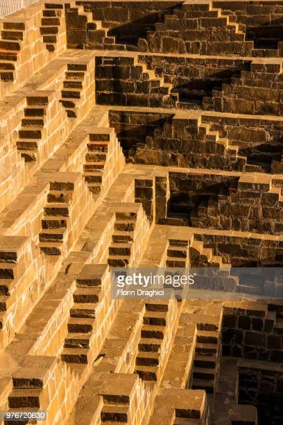 abhaneri stepped well detail - abhaneri stock photos and pictures