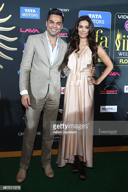 Abhay Deol and Preeti Desai arrive to the IIFA Awards at Raymond James Stadium on April 26 2014 in Tampa Florida