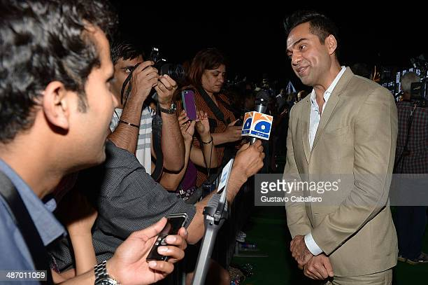 Abhay Deol is interviewed on the green carpet at the IIFA Awards at Raymond James Stadium on April 26 2014 in Tampa Florida