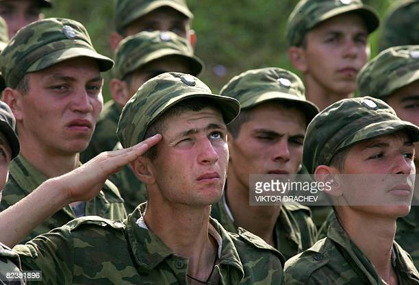 Abhazian soldiers salute the Abkhazian flag at the local military school on August 16 2008 in Sukhumi the capital of Georgia's breakaway Abkhazia...