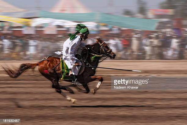 CONTENT] Abhi to mein Jwan houn an old member of tent pegging team rushing his horse to got the peg Tent pegging is a cavalry sport of ancient origin...