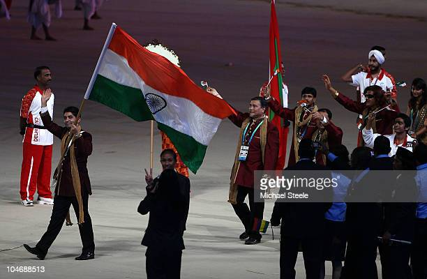 Abhinav Bindra of India carries his nation's flag during the Opening Ceremony for the Delhi 2010 Commonwealth Games at Jawaharlal Nehru Stadium on...