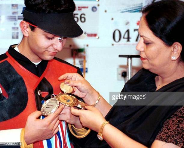 Abhinav Bindra the 18yearold shooter from Chandigarh shows his medals to his mother after his highly successful European rifle circuit tour at...