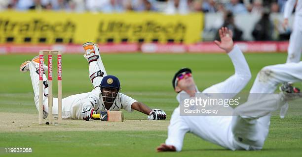 Abhinav Mukund of India dives to avoid being run out from a throw from Kevin Pietersen of England during the first npower test match between England...