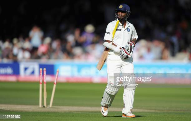 Abhinav Mukund of India leaves the field after being bowled by Stuart Broad of England during day four of the 1st npower test match between England...