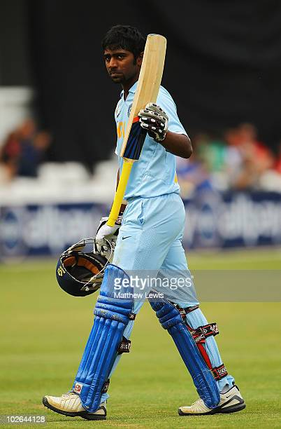 Abhinav Mukund of India walks off after he was bowled by Ravi Bopara of England during the One Day International match between England Lions and...