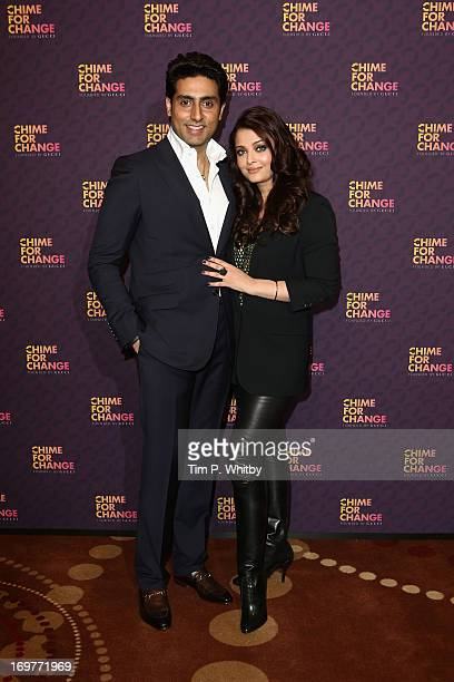 Abhishek Bachchan and Aishwarya Rai Bachchan pose backstage in the media room at the 'Chime For Change The Sound Of Change Live' Concert at...