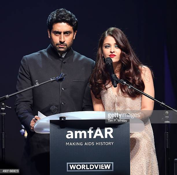 Abhishek Bachchan and Aishwarya Rai speak onstage during amfAR's 21st Cinema Against AIDS Gala Presented By WORLDVIEW BOLD FILMS And BVLGARI at Hotel...